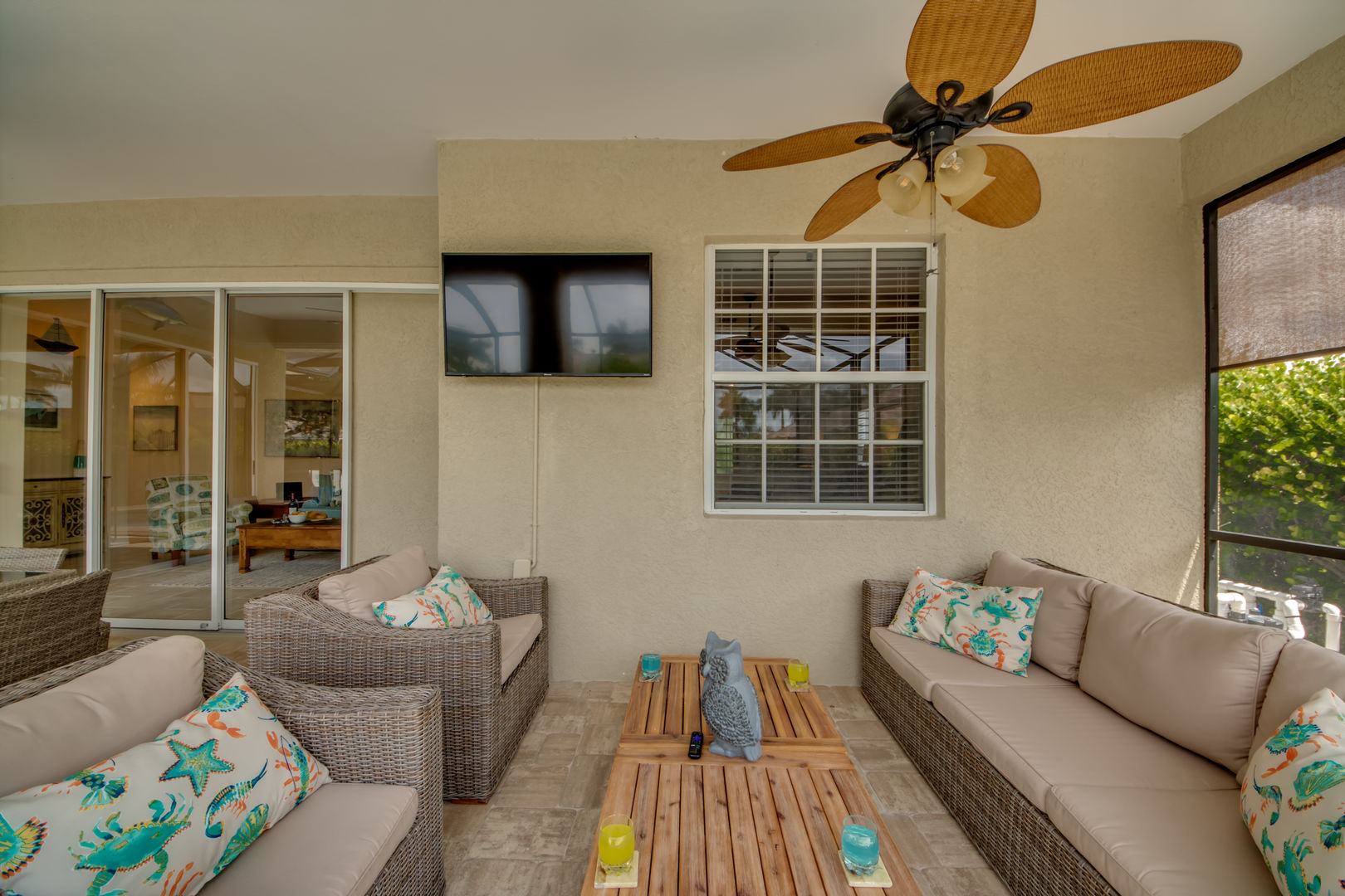 "Outside sitting area with 55"" TV"