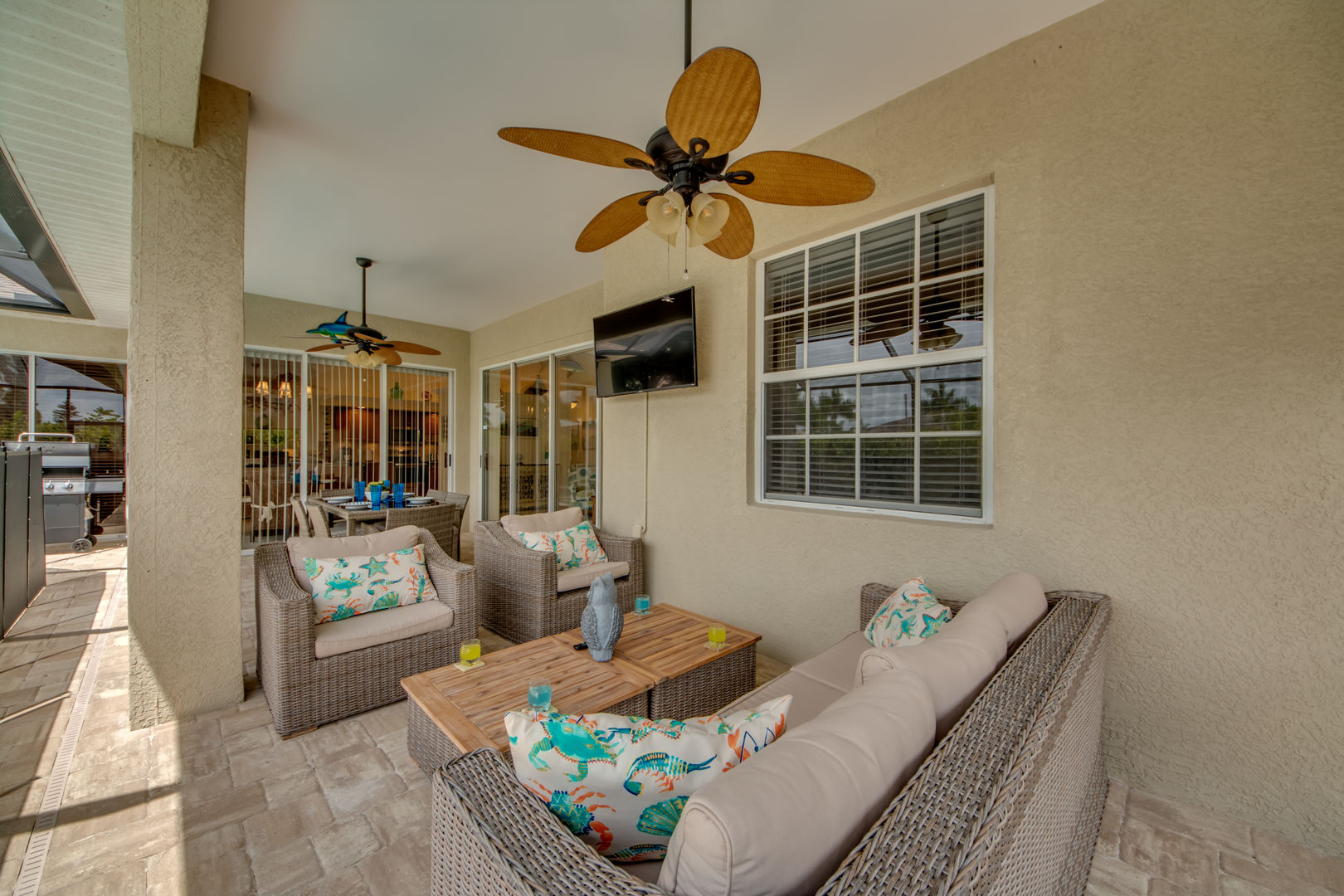 """Outside sitting area with 55"""" TV"""